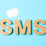 sms-word-made-from-wooden-letters-on-blue-background_185193-98